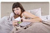 image of junk food  - young woman eating junk food before going to bed - JPG