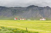 picture of iceland farm  - Iceland landscape with farms and volcanic mountains - JPG