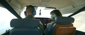 foto of male female  - A Couple Check Gauges as They Pilot a Small Plane Together - JPG