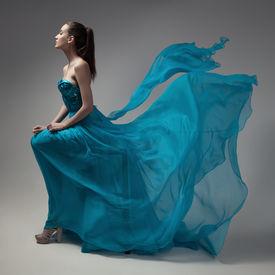 stock photo of flutter  - Fashion woman in fluttering blue dress - JPG