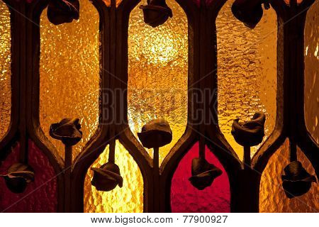 BARCELONA, SPAIN - MAY 10 2013 : Light shines through a stained glass window in the Gaudi House