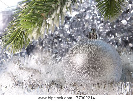 Silvery New Year's ball. Christmas still life