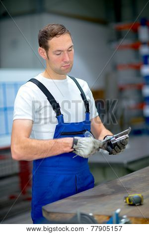 man wokring in a factory
