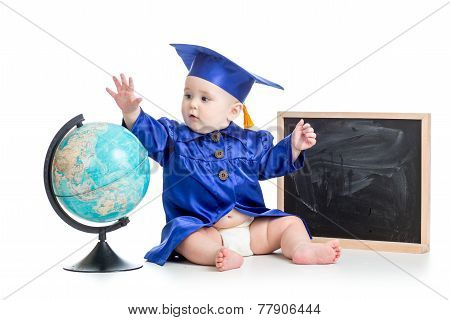baby in academician clothes with globe at chalkboard