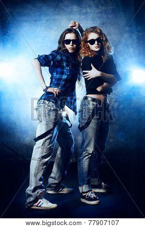 Modern hip-hop dancers over grunge background. Urban, disco style.