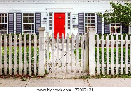 Red Door and a White Picket Fence