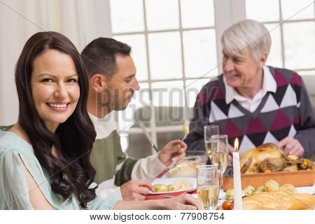 Smiling woman during christmas dinner at home in the living room