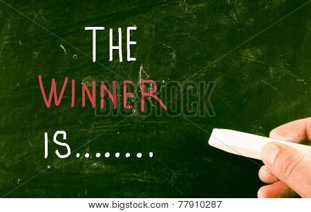 The Winner Is... handwritten with chalk