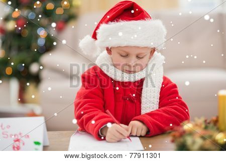 Festive little boy writing wish list against snow