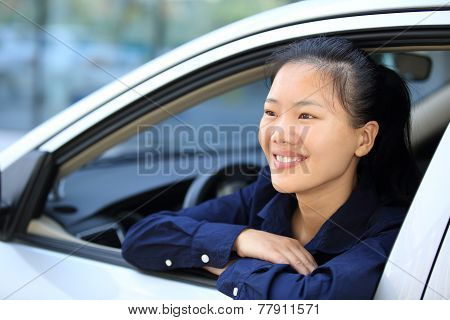 happy woman driver sit in car