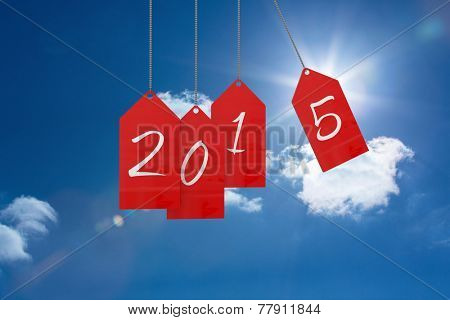 2015 red tags against bright blue sky with clouds