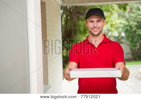Pizza delivery man delivering pizzas to a house