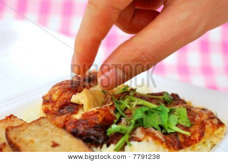 Finger Reaching For Roasted Chicken