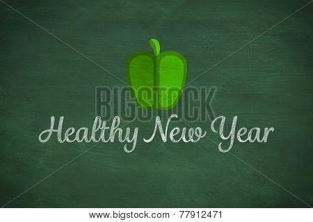 Green pepper against green chalkboard