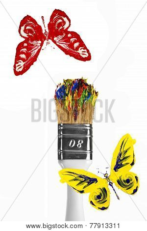 Red And Yellow Butterflies Flying Above Paintbrush