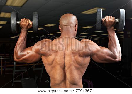 Man Lifts Dumbells