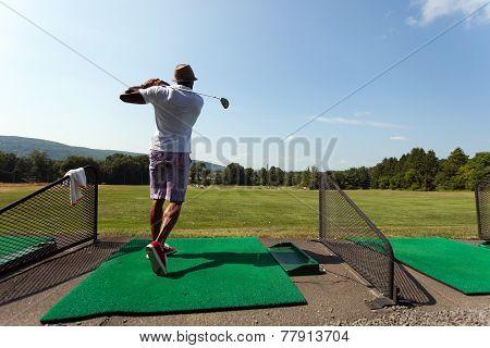 Golfer At The Driving Range