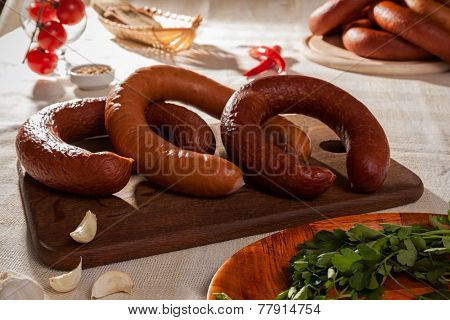 delicious sausages on a cutting board