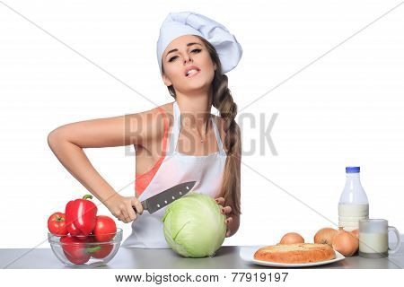 sexy female chef holding a knife with expression
