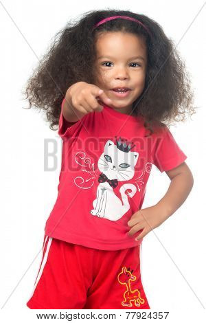 African american small girl pointing to the camera and laughing isolated on white