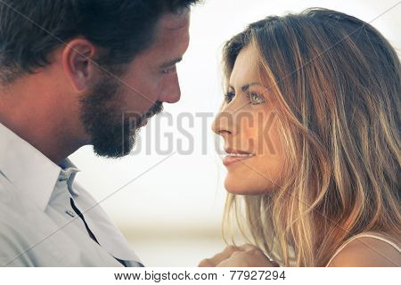 Woman And Her Man Face To Face At A Sunset