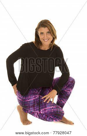 Woman Black Top And Purple Leggings Down