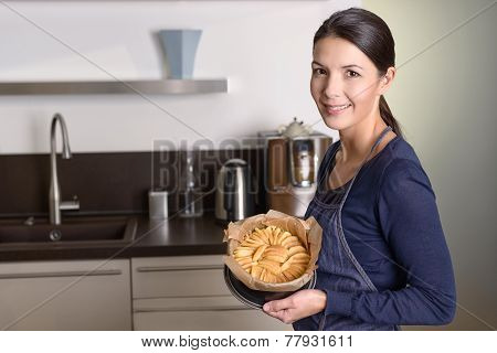 Young Woman Proudly Presenting Her Apple Tart