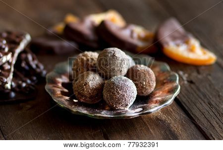 Chocolate Truffles And Orange Slices In Dark Chocolat