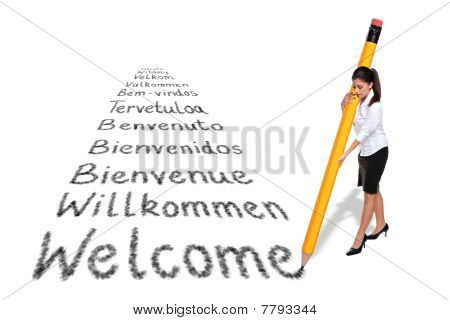 Businesswoman Writing Welcome In Various Languages With A Giant Pencil