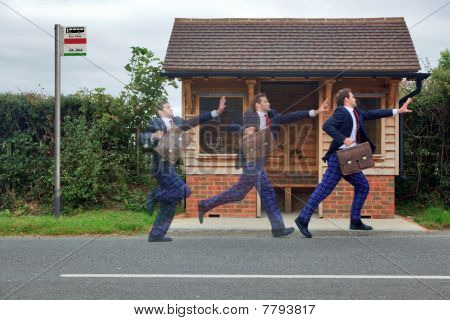 Businessman Running For The Bus