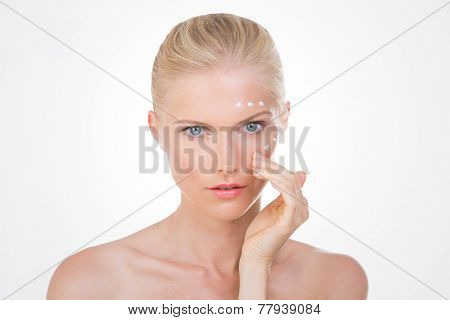 Blond Woman Checks The Effects Of Her Salve
