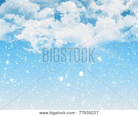 Sunny blue sky background with blizzard snow