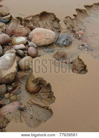 Beach Stones And Sand Erosion