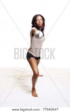 Black Woman With Fencing Foil In Lunge