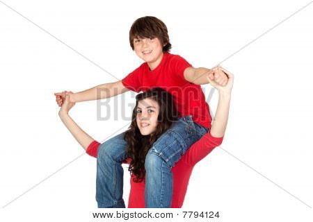 Teenage Girl With Little Boy On Her Shoulders