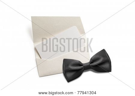 Black bow tie with blank invitation
