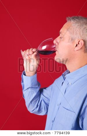 Man Drinking A Glas Of Red Wine