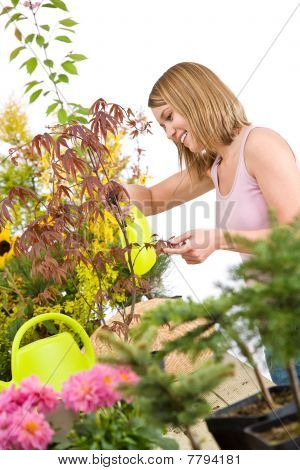 Gardening - Woman Sprinkling Water To Plant