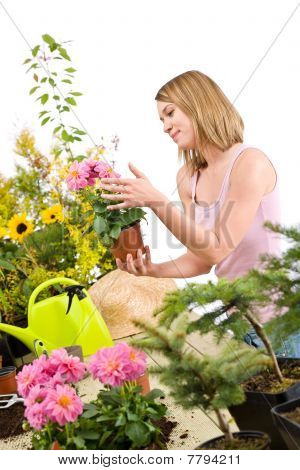 Gardening - Happy Woman Holding Flower Pot