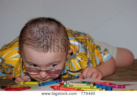 Toddler playing with crayons