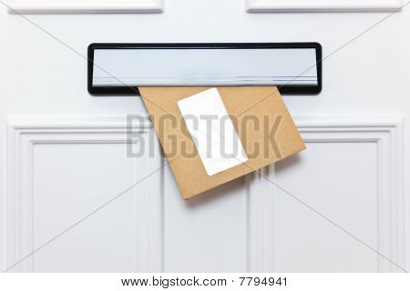 Brown Envelope In A Front Door Letterbox