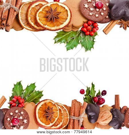 christmas border frame of cookies , berries , fruits , different xmas ingredients ,spices isolated on a white background