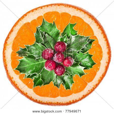 Christmas holly decoration of orange ships slice  on a white background