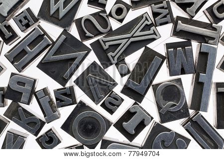 random letters in vintage letterpress metal type against white background