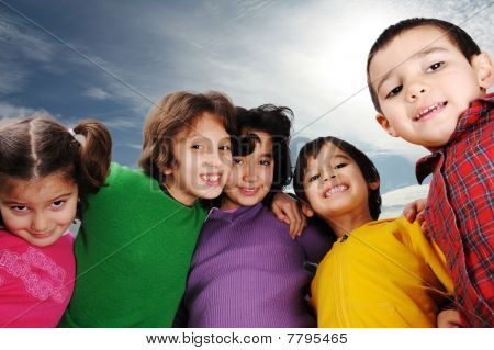 Happiness without limit, happy children together outdoor, faces, smiling and careless