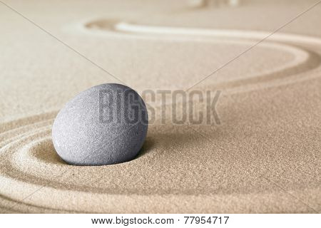 Japanese zen garden stone with lines in sand. Balance and harmony for relaxation and meditation.