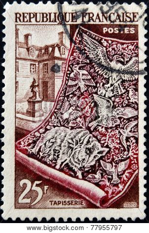 FRANCE - CIRCA 1954: a stamp printed in France shows Tapestry and Gobelin Workshop circa 1954