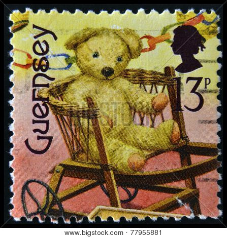 GUERNSEY - CIRCA 1994: A stamp printed in Guernsey dedicated to bygone toys shows teddy bear