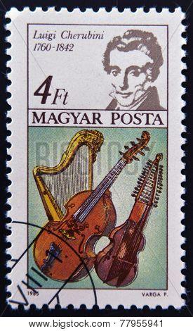HUNGARY - CIRCA 1985: A stamp printed in Hungary shows Luigi Cherubini and Harp Bass Viol