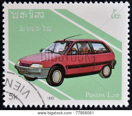 LAOS- CIRCA 1987: A stamp printed in Laos dedicated to cars shows Renault 5 circa 1987